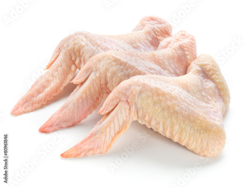 Foto op Canvas Vlees Raw chicken wings isolated on white background