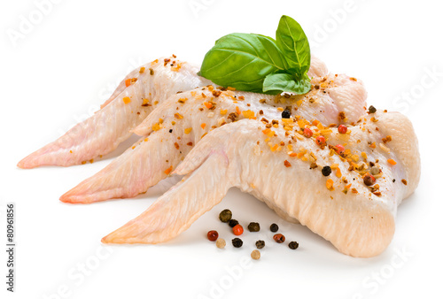 Raw chicken wings with basil and spice isolated on white - 80961856