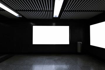 Blank billboard on wall of underpass