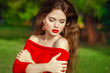 Attractive beautiful girl with fashion earring wearing in red dr