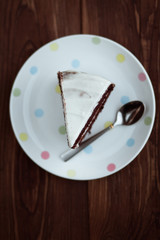 Chocolate cake in white plate on wooden table