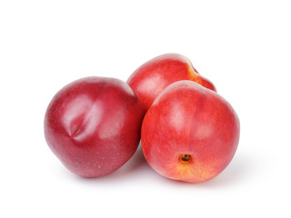 whole nectarine fruits isolated on white