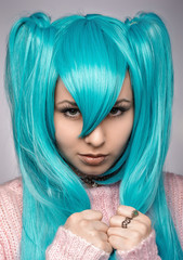 Portrait of a punk girl with blue hair