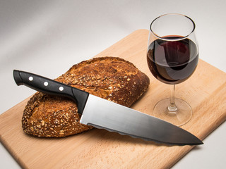Bread, wine and knife