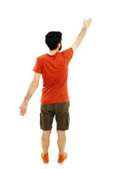 Back view of pointing young men in T shirt and shorts