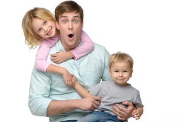 Young father with his two kids having fun