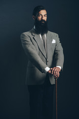 Man with Long Beard in Formal Wear Holding Cane