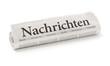 Leinwanddruck Bild - Zeitungsrolle mit der Überschrift Nachrichten