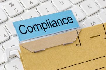 Akte mit der Beschriftung Compliance