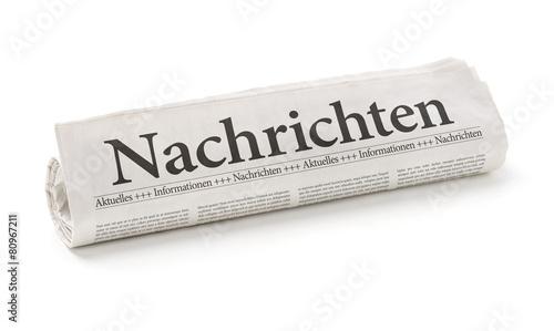 Leinwanddruck Bild Zeitungsrolle mit der Überschrift Nachrichten