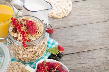 Healthy breakfast with muesli, berries, orange juice and milk