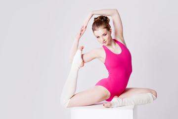 yoga poses, sport girl in pink gymnastics leotard, horizontally