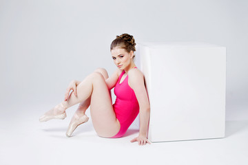 ballet dancer, sitting on the floor