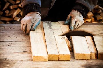 man working with circular saw