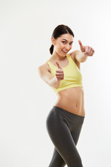 Happy fitness Young Woman Showing Thumbs Up.