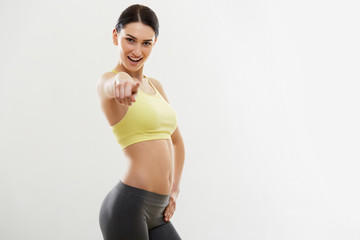 Sport Woman Pointing on You Against White Background