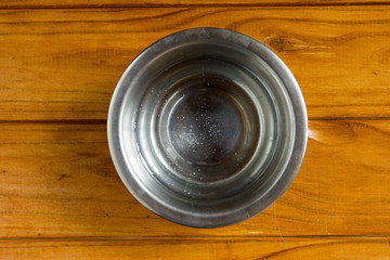 Water in metal bowl for pet