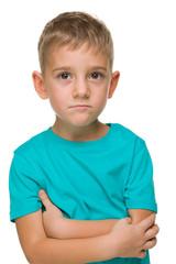 Pensive preschool boy against the white