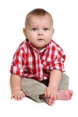 Cute baby boy sits