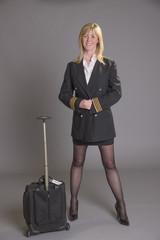 Airline officer fastening button on her uniform