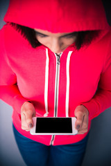 Closeup portrait of a woman holding smartphone