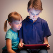 Siblings using a tablet computer