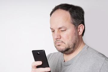 man looking at smart phone