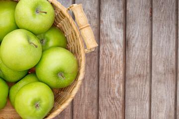 Wicker basket of crisp green apples
