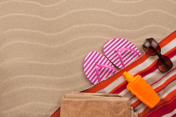 Women's accessories for the beach lying on the sand