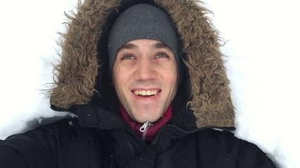 Man enjoys the snow falls