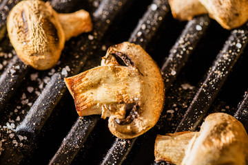 Champignon mushrooms grilled on BBQ