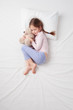 Top view of little cute girl sleeping with teddy bear - 80976434