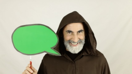 Friar holding green speech balloon funny