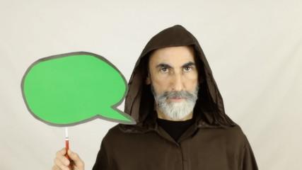 Friar holding green speech balloon serious