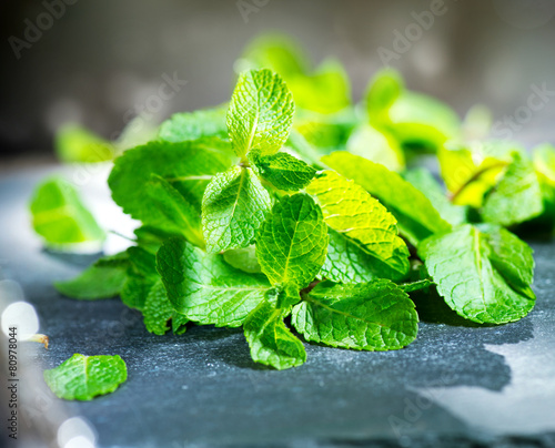 Mint. Fresh mint on a table closeup - 80978044
