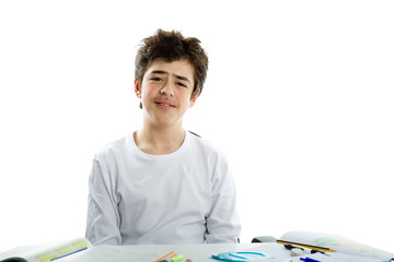 Sad Latin Boy in front of homework