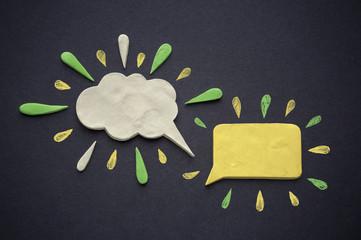 Speech bubbles of plasticine or clay