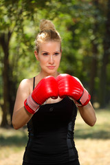 girl boxer with gloves to guard