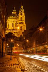 Prague street with Saint Nicolas church