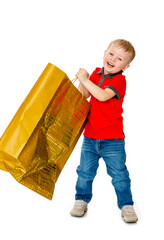 Funny little boy with a big paper bag