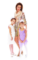 Young beautiful mother with two charming daughters.