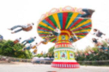 Blur background image of  roller swings in amusement park.