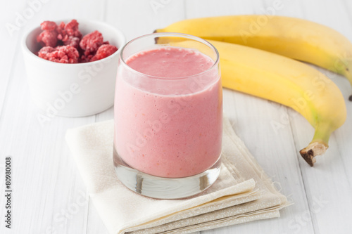 a glass of fresh homemade frozen raspberries and banana smoothie - 80980008