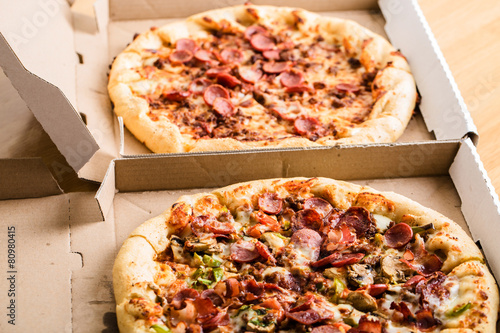 Homemade pepperoni pizza in carton box - 80980415