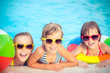 Happy children in the swimming pool - 80980801