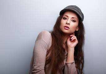 Sexy female model posing in trendy grey cap