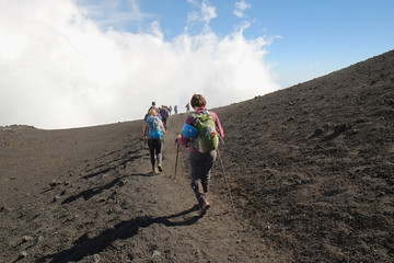 Hikers Going Down The Summit Etna Crater, Sicily