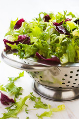Fresh green salad wix  in metal colander