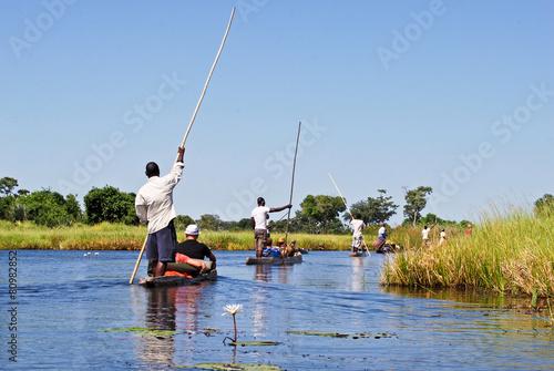 Leinwanddruck Bild Okavango Delta: Mokoro-canoe trip on the river, Botswana Africa