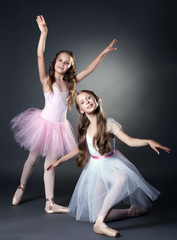 Image of two lovely ballerinas posing at camera